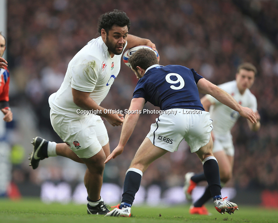 14 March 2015 - 6 Nations Rugby - England v Scotland :  Billy Vunipola of England runs at Scottish captain Greig Laidlaw.<br /> Photo: Mark Leech