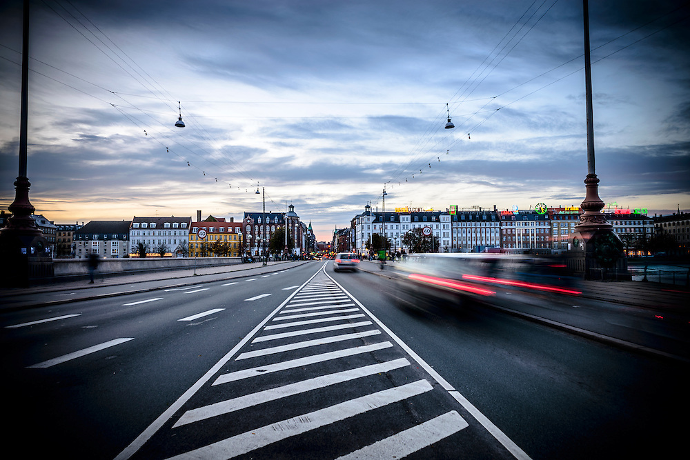 Cars and other traffic drive over Copenhagen's Dronning Louises Bro during rush hour in the early evening.