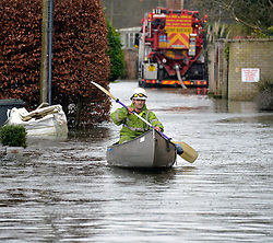 An engineer from a water company uses the only means of transport as he helps to clear the drains on Ham Island by the River Thames at Old Winsor, United Kingdom, Saturday, 8th February 2014. Picture by David Dyson / i-Images