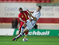 LLANELLI, WALES - Wednesday, August 15, 2012: Wales' Ashley Williams in action against Bosnia-Herzegovina's Edin Dzeko during the international friendly match at Parc y Scarlets. (Pic by David Rawcliffe/Propaganda)