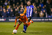 Sheffield Wednesday forward Steven Fletcher (9) bundles over Luton Town midfielder Pelly-Ruddock Mpanzu (17) during the The FA Cup 3rd round replay match between Luton Town and Sheffield Wednesday at Kenilworth Road, Luton, England on 15 January 2019.