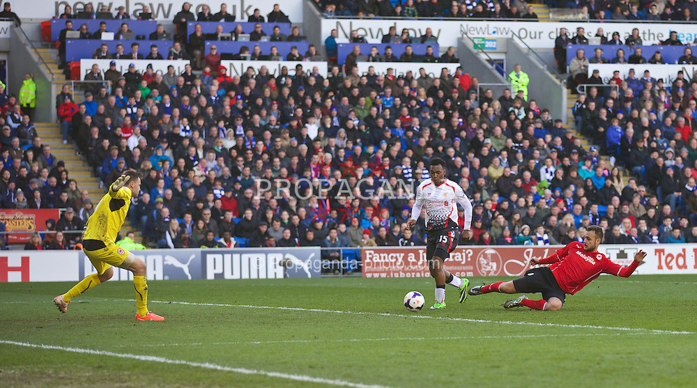 CARDIFF, WALES - Saturday, March 22, 2014: Liverpool's Daniel Sturridge scores the fifth goal against Cardiff City during the Premiership match at the Cardiff City Stadium. (Pic by David Rawcliffe/Propaganda)