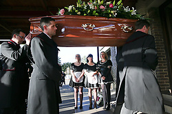 **NOTE: People in police uniform are not real policemen** © Licensed to London News Pictures. 09/12/2015. London, UK. The coffin being carried in to the crematorium past three women dressed as in maids uniforms.... The funeral of former brothel keeper Cynthia Payne takes place at the South London Crematorium.  In 1980 Cynthia Payne was sentenced to 18 months for running a brothel at her house on Ambleside Avenue in Streatham. It was alleged, at the time, that judges and Members of Parliament were visitors to her establishment. Photo credit: Peter Macdiarmid/LNP