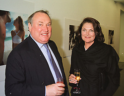 MR & MRS ANTHONY OPPENHEIMER of the De Beers diamond family, at an exhibition in London on 7th April 1999.MPU 14