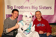 BBBS program development director Joe Strychalski (left) and and BBBS CEO Joe Radelet get a picture with the Easter Bunny at the Big Brothers Big Sisters of the Greater Miami Valley office in Moraine, Saturday, March 23, 2013.