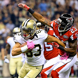 Oct 15, 2015; New Orleans, LA, USA; New Orleans Saints wide receiver Willie Snead (83) breaks a tackle by Atlanta Falcons cornerback Robert Alford (23) during the first quarter of a game at the Mercedes-Benz Superdome. Mandatory Credit: Derick E. Hingle-USA TODAY Sports