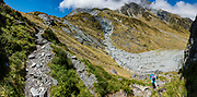 Ascending south side of Rees Saddle in Mount Aspiring National Park, Otago region, South Island of New Zealand. This image was stitched from multiple overlapping photos.