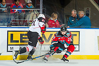 KELOWNA, CANADA - NOVEMBER 29: Jared Bethune #21 of the Prince George Cougars passes the puck past block of Leif Mattson #28 of the Kelowna Rockets on November 29, 2017 at Prospera Place in Kelowna, British Columbia, Canada.  (Photo by Marissa Baecker/Shoot the Breeze)  *** Local Caption ***