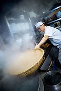 Chef Katsuzo Sugai is cooking soba noodles in the kitchen of the Sarashina Horii Restaurant. Katsuzo Sugai is 62 years old and has worked at the restaurant for 25 years. Tokyo, Japan.