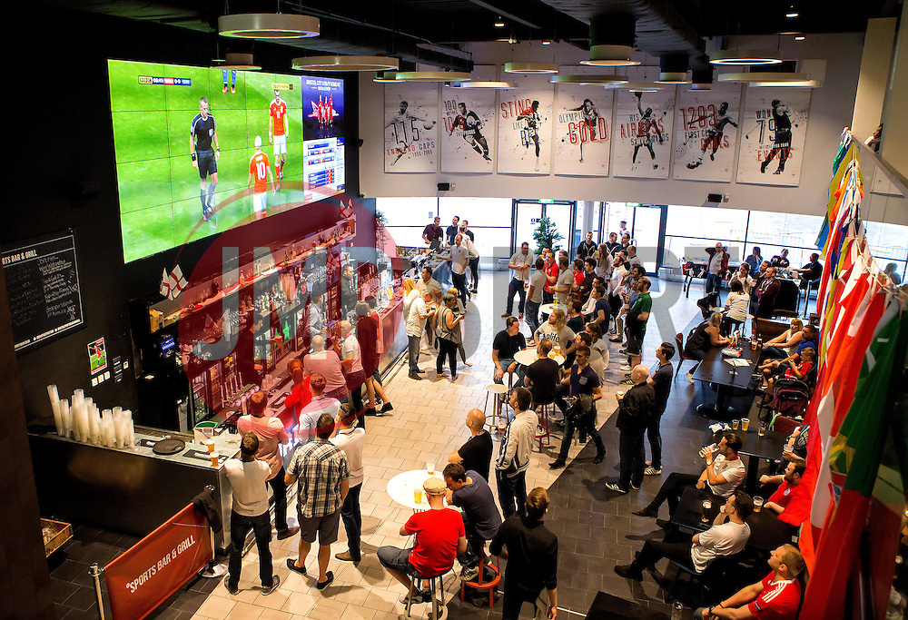 Fans watch Wales vs Slovakia on the big screen in the sports bar and grill at Ashton Gate - Mandatory by-line: Robbie Stephenson/JMP - 11/06/2016 - FOOTBALL - Ashton Gate - Bristol, United Kingdom  - England vs Russia - UEFA Euro 2016
