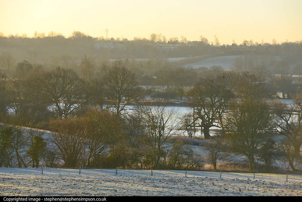 © Licensed to London News Pictures. 29/12/2013. East Bergholt, UK Views across Deadham Vale. The early morning frost and mist on the River Stour at Deadham Vale this morning 29th December 2013. Photo credit : Stephen Simpson/LNP
