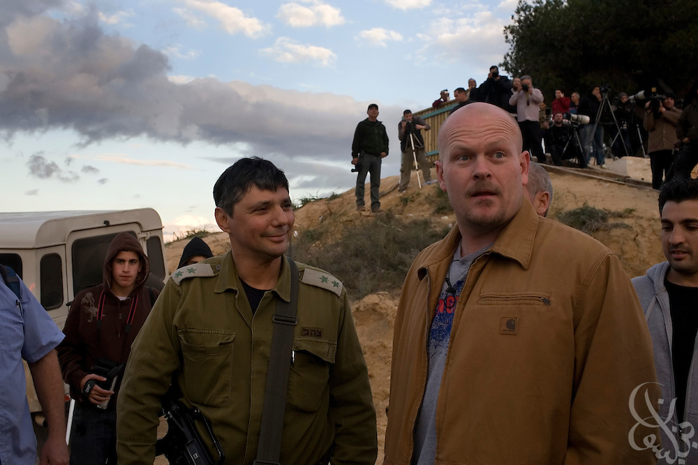 "Samuel J. Wurzelbacher, better known as ""Joe the Plumber"", is briefed by an Israeli Army spokesman from atop a hill overlooking the Gaza battlefield January 11, 2009 near Sderot, Israel. Wurzelbacher, who rose to fame during the 2008 election after questioning then presidential candidate Barack Obama about his tax plan, is in the region for about 10 days  to report for the conservative web site Pajamas TV (www.pjtv.com.)"