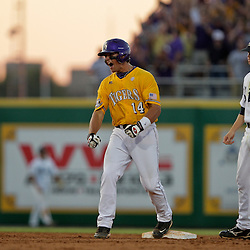05 June 2009:  Sean Ochinko (14) of LSU reacts after hitting a double that knocked in a pair of runs for the Tigers during a 12-9 victory by the LSU Tigers over the Rice Owls in game one of the NCAA baseball College World Series, Super Regional played at Alex Box Stadium in Baton Rouge, Louisiana.