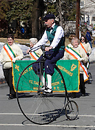 Goshen, New York -  A man wearing period costume rides an antique high wheel bicycle during the Mid-Hudson St. Patrick's Day parade on March 11, 2007.
