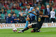 SYDNEY, AUSTRALIA - OCTOBER 27: Western Sydney Wanderers midfielder Rashid Mahazi (22) slides to tackle Sydney FC defender Michael Zullo (7) at The Hyundai A-League Round 1 soccer match between Sydney FC and Western Sydney Wanderers FC The Sydney Cricket Ground in Sydney on October 27, 2018. (Photo by Speed Media/Icon Sportswire)