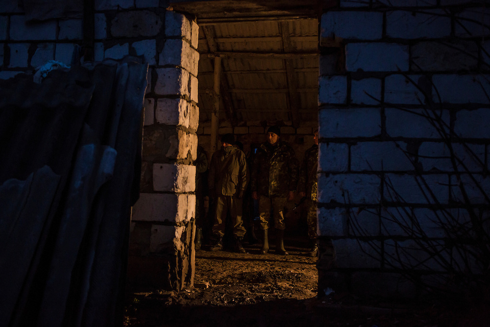 Ukrainian soldiers line up for the evening roll call and prayer at an artillery depot on Monday, December 14, 2015 near Slovyansk, Ukraine.