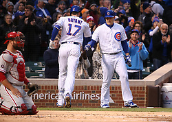 May 2, 2017 - Chicago, IL, USA - The Chicago Cubs' Kris Bryant (17) is congratulated by teammate Anthony Rizzo after Bryant hit a solo home run in the first inning against the Philadelphia Phillies at Wrigley Field in Chicago on Tuesday, May 2, 2017. (Credit Image: © Chris Sweda/TNS via ZUMA Wire)