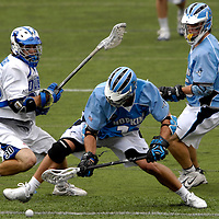 28 May 2007:  Johns Hopkins midfielder Stephen Peyser (12) fights for a ground ball off a face off in the 3rd quarter against Duke University mid fielder Terrence Molinari (30) in the NCAA Division I Lacrosse Championship game.  The Johns Hopkins Blue Jays defeated the Duke Blue Devils 12-11 to win the NCAA Division I Lacrosse championship at M&T Bank Stadium in Baltimore, Md. .