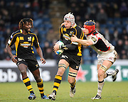Twickenham, GREAT BRITAIN, Wasps', James HASKELL attacking with the ball, tackled by, right, Scott NEWLANDS, left, Paul SACKEY, during the Heineken Cup Rugby Pool 2. Match, London Wasps vs Edinburgh , played at Adams Park, Wycombe, Buck, on Sun. 14.12.2008.  [Photo, Peter Spurrier/Intersport-images]