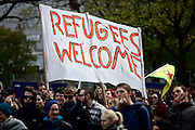 Hamburg | 01 May 2015<br /> <br /> 4000 protesters take part in the &quot;Never Mind The Papers&quot; rally for migrants and refugees in the german city of Hamburg. Picture shows the demonstration march with a big banner wich reads &quot;Refugees Welcome&quot;.<br /> <br /> &copy;peter-juelich.com<br /> <br /> [Foto honorarpflichtig | Fees Apply | No Model Release | No Property Release]