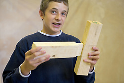 Student assembling a tenon and mortice joint in woodwork class,