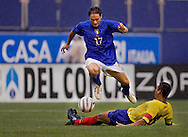 Italy's Fabio Quagliarella goes over Ecuador's Carlos Castro. (Photo by Robert Falcetti). .