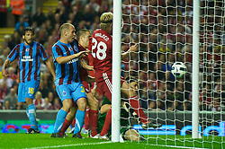 LIVERPOOL, ENGLAND - Thursday, August 19, 2010: Liverpool's Christian Poulsen scores a goal past Trabzonspor's goalkeeper Onur K?vrak but it is disallowed during the UEFA Europa League Play-Off 1st Leg match at Anfield. (Pic by: David Rawcliffe/Propaganda)