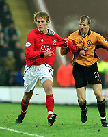 Jesper Christiansen (Kidderminster) playing in his debut game. Mark Clyde (Wolves).  Kidderminster v Wolverhampton Wanderers. FA Cup 3th rd. 3/1/2004. Credit : Colorsport/Andrew Cowie.