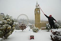 ©  London News Pictures. 18/01/2013. Windsor, UK. Model maker Paula Laughton brushing snow from a model  of the Big Ben clock tower in London Mininland at LEGOLAND Windsor resort in Windsor, Berkshire.  Photo credit : Ben Cawthra/LNP