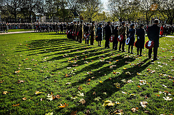 The poppy wreath party assemble and stand in silence on parade during a Remembrance Sunday service in Queen's Square, Bristol, held in tribute for members of the armed forces who have died in major conflicts.