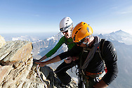 """""""Matterhorn 150 years Cervino"""" - The year 2015 is the 150th Anniversary of the first ascent by Edward Whymper from the Swiss side (14th July) and by Jean Antoine Carrel from the Italian side on the 17th July 1865.<br /> <br /> On 17th July 2015 a friendship convention was signed by the members of Swiss, French, British and Italian climbing teams. A ceremony was held at the summit in honour of the mountain.<br /> <br /> On 17th July 2015 a friendship convention was signed by the members of Swiss, French, British and Italian climbing teams. A ceremony was held at the summit in honour of the mountain."""