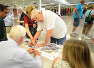 WARMINSTER, PA - AUGUST 27:   Tom McGee (C) of Warminster, Pennsylvania and his wife Donna McGee, to left in striped shirt speak with Bill Roth (L) and Meta Michener (R) of the Bucks County Department of Health during a public information session about water quality in Warminster August 27, 2014 in Warminster Pennsylvania. The meeting follows the announcement that public and private wells in Warminster (and nearby Horsham) are contaminated by two chemicals used when the Navy was operating the Naval Air Warfare Center. (Photo by William Thomas Cain/Cain Images)