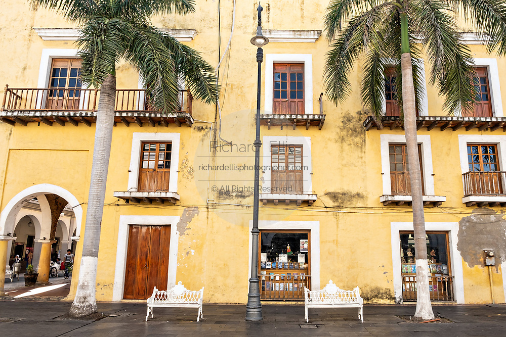 An old colonial building on the Plaza de las Armas and the Portales de Veracruz in the historic center of the city of Veracruz, Mexico. The area is the main public square in Veracruz.