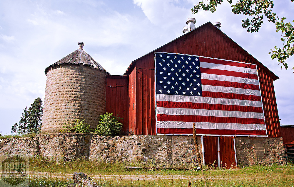 A collection of Barns that still can be seen while traveling the countryside in  the beautiful State of Wisconsin.<br /> Oneida County- Barn with American flag-Oneida County off River Road near fairgrounds. Barns from around the State of Wisconsin.