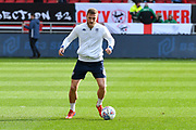 Liam Cooper (6) of Leeds United warming up before the EFL Sky Bet Championship match between Bristol City and Leeds United at Ashton Gate, Bristol, England on 9 March 2019.