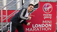 Olympic diver Tom Daley is the starter for the VMG Mini London Marathon races at Billingsgate during the Virgin Money London Marathon 2014 on Sunday 13 April 2014<br /> Photo: Paul Gregory/Virgin Money London Marathon<br /> media@london-marathon.co.uk