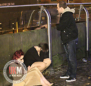 Manchester UK  24.12.2016: Images from Manchesters Gay Village during the Mad Friday celebrations this on the 23 and 24th of December,<br /> <br /> Two females appear to be asleep in the street