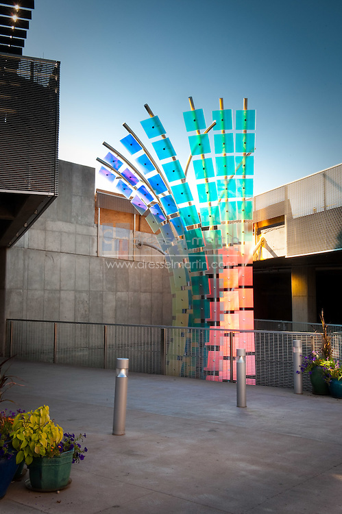 Albedo by Osman Akan is installed in the DBG Parking Structure Atrium. Akan is wearing the suit jacket and glasses