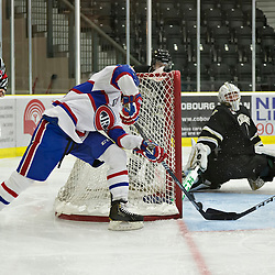 COBOURG, ON - Oct 21 : Ontario Junior Hockey League Game Action between Cobourg Cougars Hockey Club & Toronto Junior Canadians Hockey Club, Aaron Spivak #25 of the Toronto Canadiens Hockey Club shoots the puck<br /> (Photo by Dave Powers / OJHL Images)