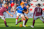 Scott Arfield (#37) of Rangers FC shields the ball from Aaron Hickey (#51) of Heart of Midlothian FC, as Oliver Bozanic (#7) of Heart of Midlothian FC and Jake Mulraney (#11) of Heart of Midlothian FC watch during the Ladbrokes Scottish Premiership match between Heart of Midlothian and Rangers FC at Tynecastle Park, Edinburgh, Scotland on 20 October 2019.