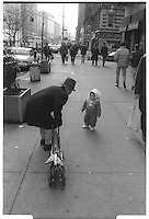Grand-father talking to grand child, Broadway, NYC. Street photography. 1980