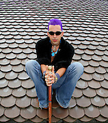 young punk sitting on roof top