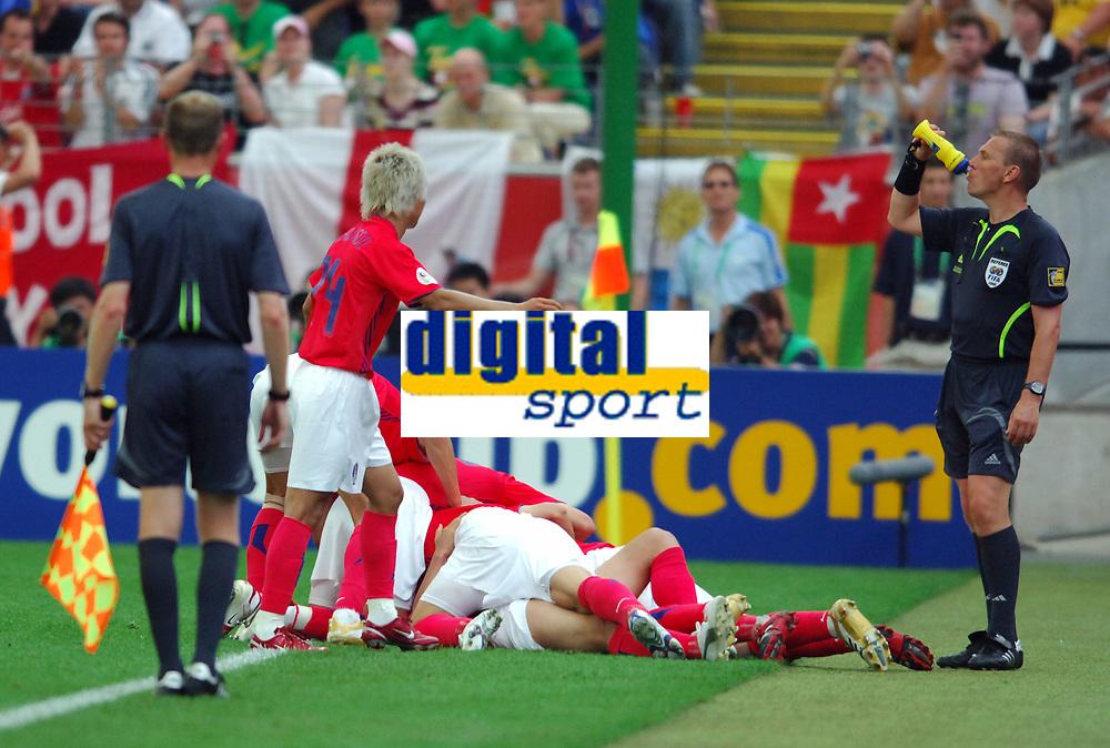 World Cup 2006 Germany Frankfurt 13/06/2006<br />Korea v Togo (2-1)<br />English Referee Graham Poll (on his wedding anniversary) takes a swig as Korea celebrtae winning goal<br />Photo Roger Parker Fotosports International