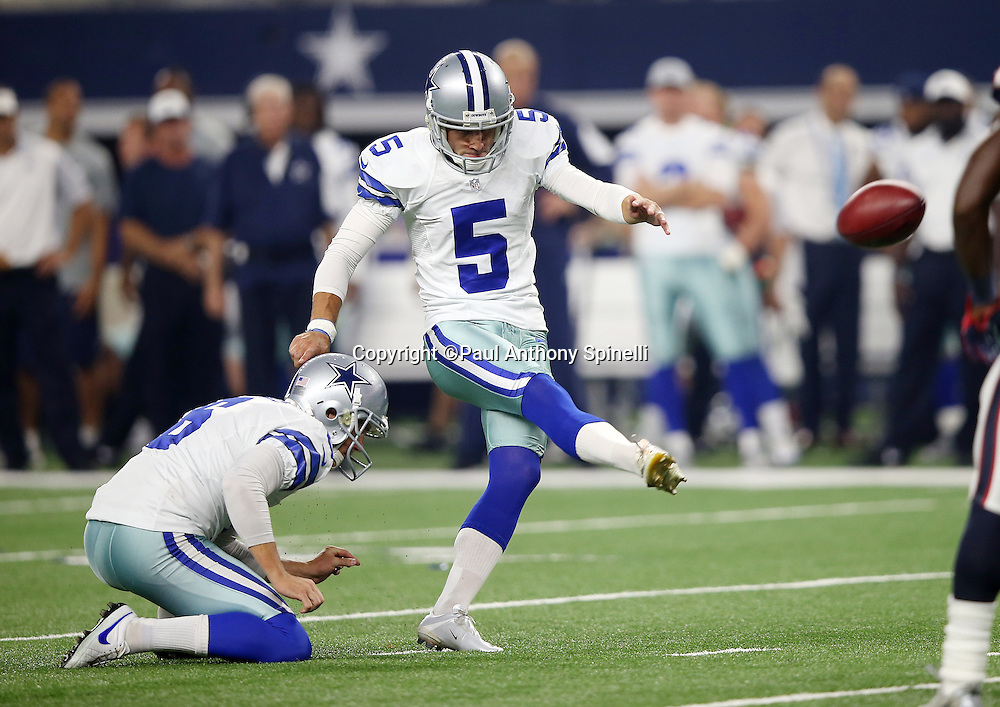 Dallas Cowboys punter Chris Jones (6) holds while Dallas Cowboys kicker Dan Bailey (5) kicks an extra point that gives the Cowboys a 14-7 third quarter lead during the 2015 NFL preseason football game against the Houston Texans on Thursday, Sept. 3, 2015 in Arlington, Texas. The Cowboys won the game 21-14. (©Paul Anthony Spinelli)