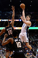 Mar 17, 2017; Phoenix, AZ, USA; Orlando Magic guard Mario Hezonja (8) shoots the ball over Phoenix Suns forward Alan Williams (15) in the first half of the NBA game at Talking Stick Resort Arena. Mandatory Credit: Jennifer Stewart-USA TODAY Sports