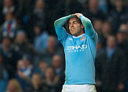 WIGAN, ENGLAND - Monday, March 29, 2010: Manchester City's Carlos Tevez is frustrated as he side struggle against Wigan Athletic during the Premiership match at the City of Manchester Stadium. (Photo by David Rawcliffe/Propaganda)