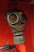 "Gas mask from the First World War. Scheduled to run through 2018 at York Castle Museum, the First World War Exhibition, ""1914: When the World Changed Forever"" opened on 28 June 2014, exactly 100 years after Archduke Franz Ferdinand was assassinated, sparking a chain of events leading to war. York Castle Museum was founded in 1938 by Dr John Kirk, a doctor from Pickering, North Yorkshire. The museum houses Kirk's extraordinary collection of social history, reflecting everyday life in the county, including a fullscale Victorian reconstruction of Kirkgate street, a recreated Jacobean dining rooms (1567–1625), a history of children's toys, and exhibits on the First World War through the 1960s. The York Castle Museum is housed in a former debtors' prison (built in 1701–05 using stone from castle ruins) and in an adjoining former women's prison (built 1780–85) in North Yorkshire, England. Originally built by William the Conqueror in 1068, York Castle features a ruined keep now called ""Clifford's Tower."""
