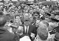 95250<br /> <br /> American President John Fitzgerald Kennedy (J.F.K.)'s visit to Ireland June 1963.<br /> Wexford, June 27, 1963.<br /> The American President walks through a crowd of people including Garda&iacute;.<br /> (Part of the Independent Newspapers Ireland/NLI collection.)