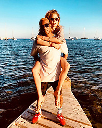"""Doutzen Kroes releases a photo on Instagram with the following caption: """"\u2665\ufe0f take me back! #throwback #tbt @sunneryjames"""". Photo Credit: Instagram *** No USA Distribution *** For Editorial Use Only *** Not to be Published in Books or Photo Books ***  Please note: Fees charged by the agency are for the agency's services only, and do not, nor are they intended to, convey to the user any ownership of Copyright or License in the material. The agency does not claim any ownership including but not limited to Copyright or License in the attached material. By publishing this material you expressly agree to indemnify and to hold the agency and its directors, shareholders and employees harmless from any loss, claims, damages, demands, expenses (including legal fees), or any causes of action or allegation against the agency arising out of or connected in any way with publication of the material."""