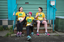 © Licensed to London News Pictures. 17/04/2017. Gawthorpe UK. Competitors rest after taking part in the women's race of The World Coal Carrying Championships in the village of Gawthorpe in Yorkshire. Every year Men & women carry huge sacks of coal from the Royal Oak Pub in Ossett 1012 metres to the finish line at the Maypole Green in the village of Gawthorpe. Photo credit: Andrew McCaren/LNP